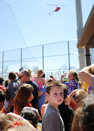 Adults and children look up to the sky as the first batch of eggs are about to be released during the Helicopter Easter Egg Drop at Vissing Park in Jeffersonville Saturday afternoon.<br /> Staff photo by Tyler Stewart
