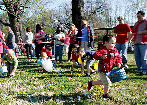 Logan Conklin, 3, Sellersburg, doesn't waste time after the call came to start Colgate Park's Easter egg hunt on Saturday. The eggs were all picked up in about two minutes. Staff photo by Jerod Clapp