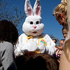 Children and parents crowd around to get pictures taken with the Easter Bunny after he rode in on  Clarksville Fire Department truck on Saturday. The Easter Bunny visited Colgate Park after the Easter egg hunt was finished. Staff photo by Jerod Clapp