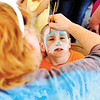 Seven-year-old James Frazier gets his face painted like a bunny during the Helicopter Easter Egg Drop event at Vissing Park in Jeffersonville Saturday afternoon.<br /> Staff photo by Tyler Stewart