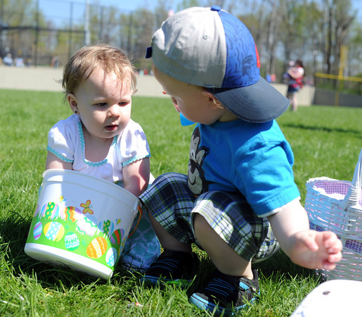 Claire Jones, 1, and cousin, Clark Stewart, 2, go through their Easter baskets after the Helicopter Egg Drop at Vissing Park Saturday afternoon in Jeffersonville.<br /> Staff photo by Tyler Stewart