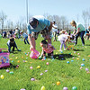 Parents and children in the 1 to 4 year old group gather eggs in Vissing Park after the Jeffersonville Park Department dropped them by Helicopter Saturday afternoon.<br /> Staff photo by Tyler Stewart