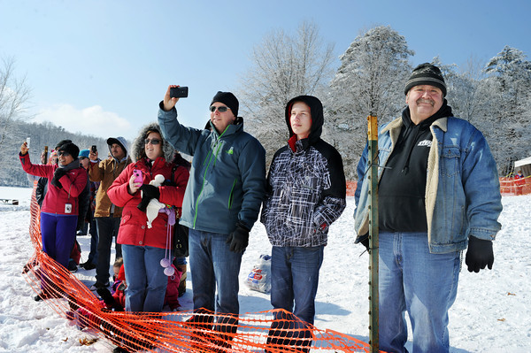 Spectators watch as Polar Plunge participants enter Deam Lake Saturday morning. With a little more than a foot of ice covering the lake, Indiana State Police used a chain saw to carve out a place for people to plunge.<br /> Staff photo by Tyler Stewart