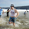 Polar Plunge participant Bobby Butler dashes through the frigid water in style at Deam Lake. With a little more than a foot of ice covering the lake, Indiana State Police used a chain saw to carve out a place for people to plunge. <br /> Staff photo by Tyler Stewart