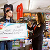 Terry Spalding, 20, Georgetown, receives a check from Desiree Brewer of the Hoosier Lottery at the Georgetown Express Mart along Ind. 64 on Wednesday afternoon. Spalding purchased a winning Cash For Life ticket on Feb. 3, and will receive $500 dollars a week for the rest of his life. He is the youngest person to win a top prize in the game. Staff photo by Christopher Fryer