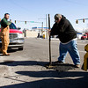 New Albany Street Department laborer Roger Goodale, Georgetown, packs cold patch, which is a mixture of tar and fine gravel, into a pothole at the corner of Spring and Silver streets in New Albany on Tuesday afternoon. Staff photo by Christopher Fryer