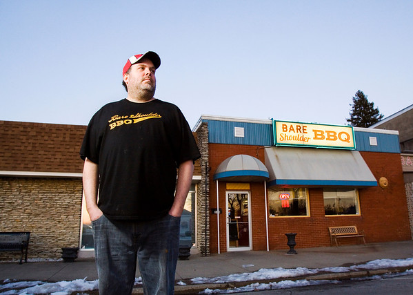 Owner Drew Salamone stands outside of Bare Shoulder BBQ in downtown Charlestown on Thursday evening. Staff photo by Christopher Fryer