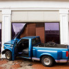A Ford truck sits on the sidewalk along the 100 block of East Spring Street after the driver of the vehicle left the roadway, hit a light pole and collided with The Elsby building at about 3:15 p.m. in downtown New Albany on Monday. Staff photo by Christopher Fryer