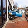 Emergency officials work the scene of an accident along the 100 block of East Spring Street after a Ford truck left the roadway, hit a light pole and collided with The Elsby buidling in downtown New Albany on Monday afternoon. The accident occurred at about 3:15 p.m., and the driver of the vehicle was taken to Floyd Memorial Hospital. Staff photo by Christopher Fryer