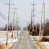 Power lines hang above a section of Bethany Road in Charlestown on Wednesday afternoon. Staff photo by Christopher Fryer