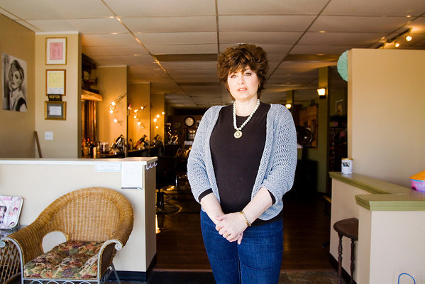 Owner and stylist Melissa DuVall stands inside of Absolutely You Salon in downtown Charlestown on Wednesday afternoon. Staff photo by Christopher Fryer