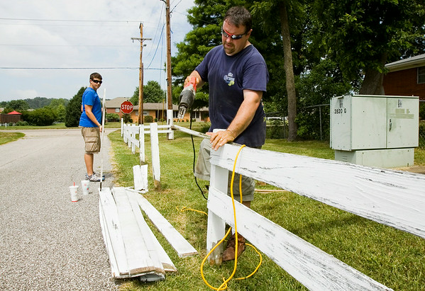 Vince Hopper, right, and his nephew, Noah Burgin, both of Georgetown, work to repair a fence at the Floyd County 4-H Fairgrounds in preparation for the start of the fair next week in New Albany. Staff photo by Christopher Fryer
