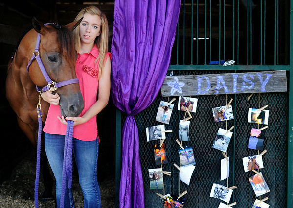 Breann Hendrickson, 19, Charlestown, and her horse, Daisy, pause before leaving her stall at the Clark County 4-H fairgrounds Thursday afternoon. Hendrickson has competed in a multitude of events over the past 10 years in the 4-H, and will now be moving on to national shows at the end of the season. <br /> Staff photo by Tyler Stewart