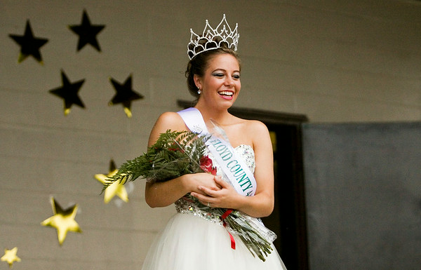 Audrey Wilson, 18, Floyds Knobs, poses for photographs after being named the 2014 Floyd County 4-H Fair Queen at the fairgrounds in New Albany on Monday evening. Staff photo by Christopher Fryer