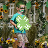 "Gabriel Upchurch, 5, New Albany, makes his way off the stage during the 4-H Children's Costume Contest in the community building of the Clark County 4-H fairgrounds. Upchurch dressed as ""Mr. 4-H"" in the 3-year-old to preschool ""Explorer"" category Wednesday.<br /> Staff photo by Tyler Stewart"