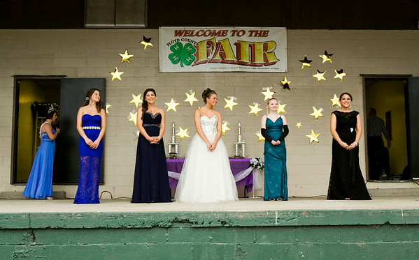 The candidates wait for the judges to make their decision during the Floyd County 4-H Fair Queen Contest at the fairgrounds in New Albany on Monday evening. Audrey Wilson, center right, won the contest, and Kendall Lanham, second from the right, was named 2014 Floyd County 4-H Fair Princess. Staff photo by Christopher Fryer