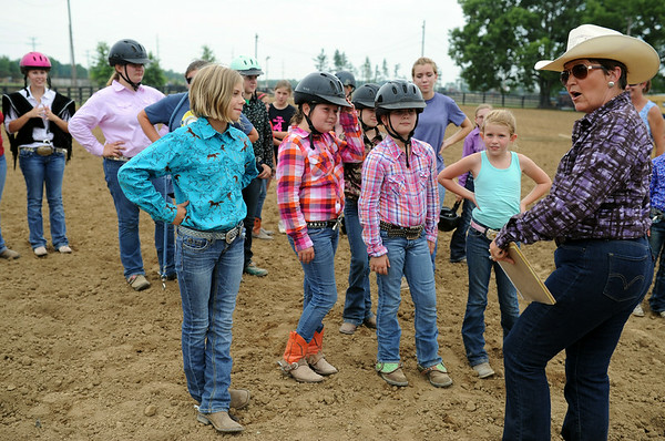 Judge Juanita Hobbs reviews the course and guidelines with participants of the Trail Class before competition begins at the Clark County 4-H arena Saturday.<br /> Staff photo by Tyler Stewart