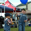 Brendan Allgeier, 2, Charlestown, takes a break from his sucker, while his brother Avery, 4, pulls on the string of his balloon at the Clark County 4-H fairgrounds Wednesday. The Allgeier's dressed as farmers in the 4-H Children's costume contest earlier in the day. <br /> Staff photo by Tyler Stewart