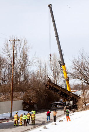 Crews with Padgett and CSX work to pull a semitrailer out from underneath a railroad overpass along Emery Crossing next to Marshall's Auto Parts in Clarksville on Friday afternoon. The accident occurred at about 9:45 a.m. on Friday. Staff photo by Christopher Fryer