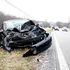 A Toyota Corolla hit a Ford Expedition after it lost control on an icy hill on U.S. 150 on the border of Floyd and Harrison counties just before 11:30 a.m. on Thursday. Three accidents happened within minutes of each other on U.S. 150 and slick roads in Clark County caused drivers to exercise a little extra caution. Staff photo by Jerod Clapp