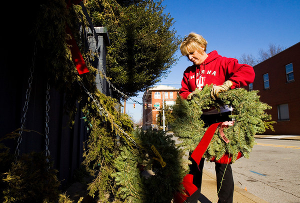 Celine Day, Clarksville, breaks down Christmas decorations at Nance's Florist along Spring Street in New Albany on Tuesday afternoon. Staff photo by Christopher Fryer