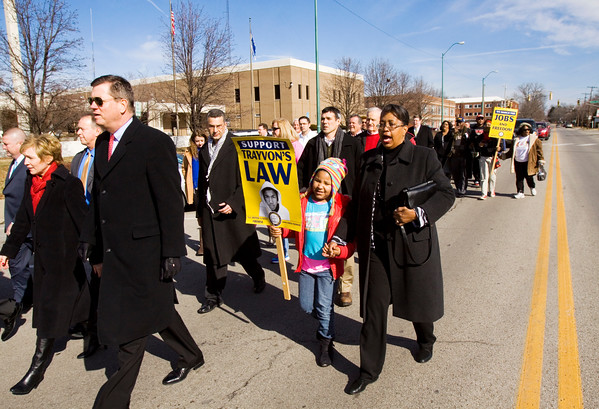 Participants move down East Court Avenue during a march in honor of Dr. Martin Luther King Jr. in Jeffersonville on Monday afternoon. Staff photo by Christopher Fryer