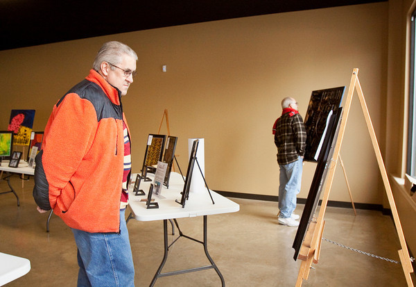 Stephen Scott, New Albany, views artwork made by disabled artists at The Studio at the Fairmont Neighborhood Center during a public display in the Central Christian Church Activities and Programs Building in New Albany on Saturday afternoon. Staff photo by Christopher Fryer