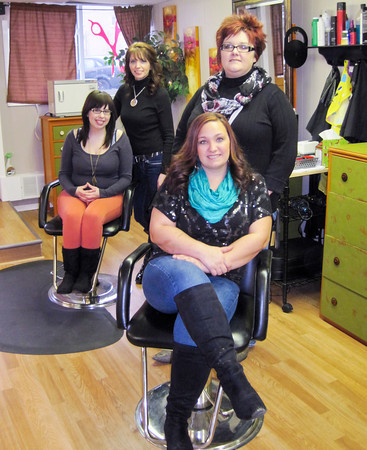 Standing from left are stylist Carrie Lowery and owner Paula Marler. Sitting from left are Faith Robinson and Kameron Middleton of The Red Head Stepchild Salon & Spa in downtown New Albany. Staff photo by Daniel Suddeath Paula Marler. Sitting from left are Faith Robinson and Kameron Middleton of The Red Head Stepchild Salon & Spa in downtown New Albany. Staff photo by Daniel Suddeath