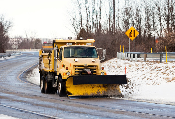 An Indiana Department of Transportation snowplow moves down the exit ramp at mile 123 of Interstate 64 in New Albany on Saturday afternoon. Staff photo by Christopher Fryer