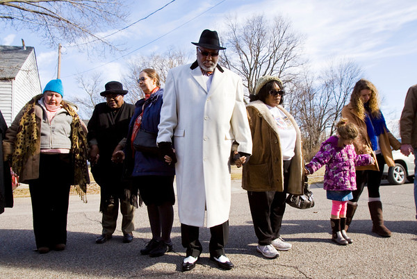 Participants holds hands during a prayer outside of St. Luke's United Church of Christ following a march in honor of Dr. Martin Luther King Jr. in Jeffersonville on Monday afternoon. Staff photo by Christopher Fryer