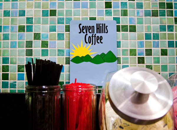A sign for Seven Hills Coffee hangs next to the coffee bar at Swirlz Yogurt and Coffee, located at 2784 Meijer Drive in Jeffersonville. Staff photo by Christopher Fryer