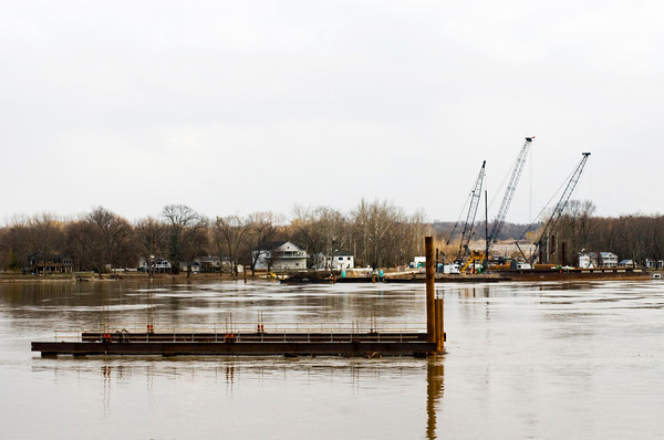 Construction equipment sits on the Kentucky side of the Ohio River at the site of the East End Bridge near Utica earlier this year. Staff photo by Christopher Fryer