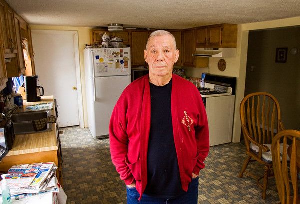 Lifelong Utica resident Clarence Snelling stands in his kitchen in downtown earlier this year. Staff photo by Christopher Fryer