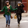 Kat Nye, 16, Floyds Knobs, and Jakob Berry, 16, Sellersburg, run across East Market Street on their way to Quills Coffee in downtown New Albany on Thursday afternoon. Staff photo by Christopher Fryer