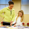 Wendy Smith, 41, New Albany, and her daughter, Madison, 7, work together on a handmade book at the Carnegie Center for Art and History's Day at the Museum on Friday. The museum gave children something to do during their winter break from school. Staff photo by Jerod Clapp