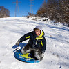 Braden Obremski, 8, New Albany, sleds down a hillside above the Floyd County 4-H Fairgrounds in New Albany on Tuesday afternoon. According to the National Weather Service, Wednesday will see a high near 26. Staff photo by Christopher Fryer