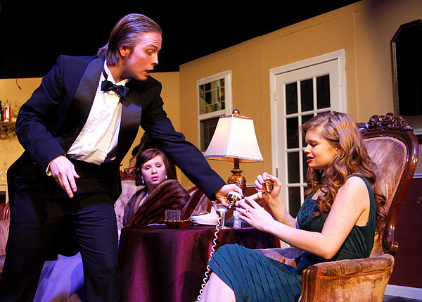 "Sam Maxwell, junior, quickly hands off the phone receiver to Megan Resto, freshman, during a scene in Silver Creek High School's production of ""Rumors."" The farce centers around four upper-crust couples who arrive for a dinner party, but through a series of comical mishaps, have to end up trying to keep the night's events from going public. The show opens tonight at 7:30 p.m. with two more shows tomorrow at 2 p.m. and 7:30 p.m. Tickets are $10 for adults and $6 for students, which may be purchased at the door. Staff photo by Jerod Clapp"