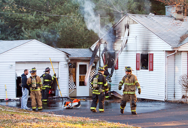 Jeffersonville firefighters work the scene of a structure fire at 1506 Ellwanger Ave. that started as a grease fire on a stove-top in the Jeffersonville residence on Tuesday afternoon. Staff photo by Christopher Fryer