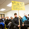 Floyd County resident Tim Fentress holds a sign to protest a controversial zoning change while attending a meeting of the Floyd County Plan Commission at the Pine View Government Center in New Albany on Wednesday evening. Staff photo by Christopher Fryer