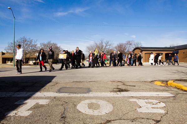 Participants turn on to Walnut Street from East Court Avenue during a march in honor of Dr. Martin Luther King Jr. in Jeffersonville on Monday afternoon. Staff photo by Christopher Fryer