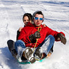 Tyler Rhea and Victoria Murphy, both of New Albany, make their way down a hillside above the Floyd County 4-H Fairgrounds while sledding in New Albany on Tuesday afternoon. According to the National Weather Service, Wednesday will see a high near 26. Staff photo by Christopher Fryer