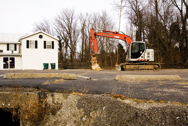 An excavator sits in the parking lot of Aces and Eights Bar and Grill near the intersection of Grant Line Road and Daisy Lane in New Albany on Tuesday afternoon. A section of Grant Line Road at this site could be closed for up to 60 days due to drainage improvements that could begin by March 1. Staff photo by Christopher Fryer