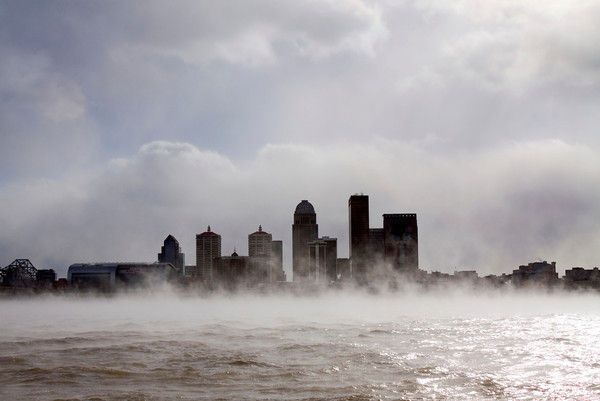 A fog, caused by the air temperature being colder than the water temperature, rolls across the Ohio River near downtown Louisville on Monday afternoon. According to the National Weather Service, temperatures will remain cold today with a high of 13. Staff photo by Christopher Fryer