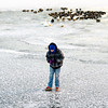 "Noah Deem, 13, New Albany, plays on the ice-covered lake at Sam Peden Community Park in New Albany on Tuesday afternoon. ""It's kind of scary,"" Deem said about being that far out on the ice for the first time. According to the National Weather Service, local temperatures will be warmer on Wednesday with a high near 35. Staff photo by Christopher Fryer"