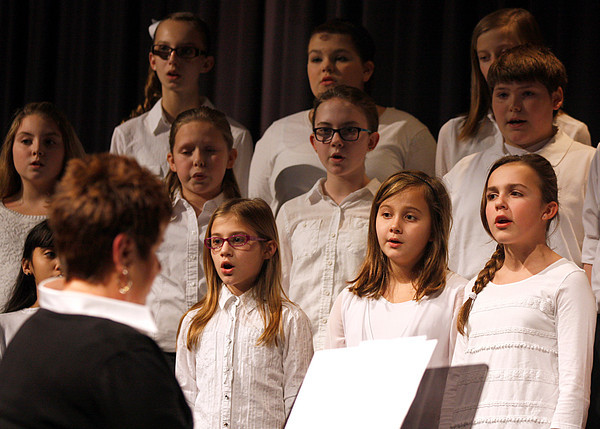 Sixth-graders in the Scribner Middle School Choir sing for the 19th Annual Martin Luther King Commemorative Dinner on Tuesday as Ellen Hamilton, director of the choir, plays the piano. This year's event focused on the importance of being a good citizen for civil rights. Staff photo by Jerod Clapp