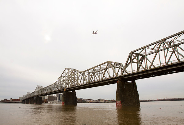 An airplane flies above the Clark Memorial Bridge towards Louisville last month. Staff photo by Christopher Fryer