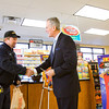 Hoosier Millionaire Host Mark Patrick sells a scratch-off ticket to customer Bill Brock, Cincinnati, during a launch event for the 25th anniversary edition of the game at Sav-A-Step along Veterans Parkway in Jeffersonville on Thursday morning. Scratch-off tickets for the game went on sale statewide on Tuesday, and the first live game show will be held in Evansville on March 27. Staff photo by Christopher Fryer