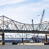 Traffic moves across the John F. Kennedy Memorial Bridge above construction equipment being used for the Ohio River Bridges Project on Monday afternoon. Staff photo by Christopher Fryer