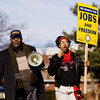 Gary Leavell and Demetria Towns, 15, both of Jeffersonville, move down Walnut Street during a march in honor of Dr. Martin Luther King Jr. in Jeffersonville on Monday afternoon. Staff photo by Christopher Fryer