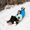 Tiffany Jones, right, and Laney Thompson, both of New Albany, sled down a hillside above the Floyd County 4-H Fairgrounds in New Albany on Tuesday afternoon. According to the National Weather Service, Wednesday will see a high near 26. Staff photo by Christopher Fryer